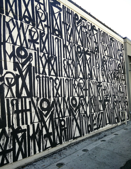 black and white graphic mural painted on a wall