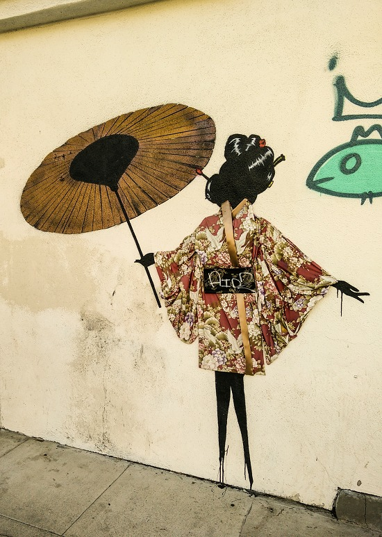 street art a silhouette of a woman wearing a kimono