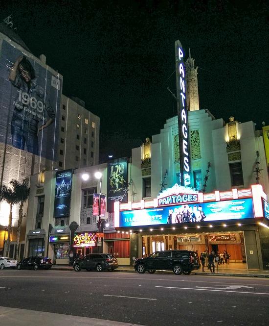 a lit up theatre front