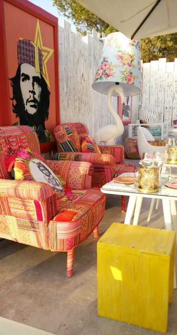 colourful patchwork chairs and bright table settings