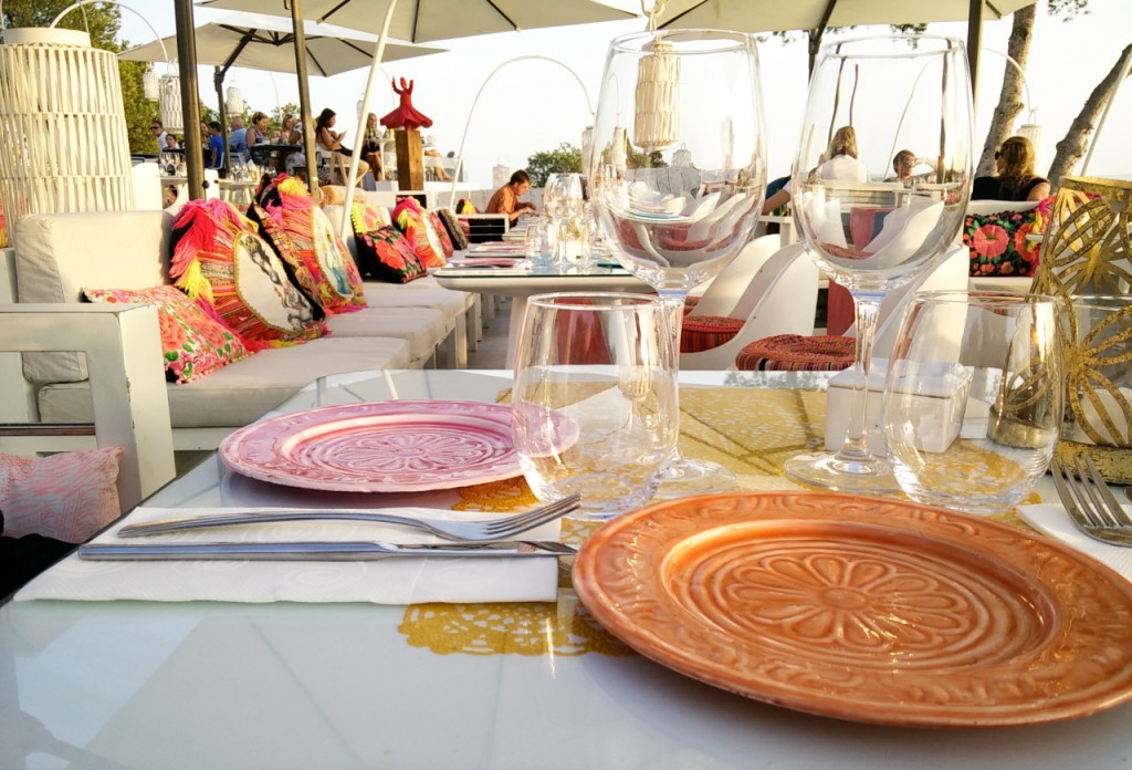 colourful restaurant rooftop setting with colourful cushions and dinner plates