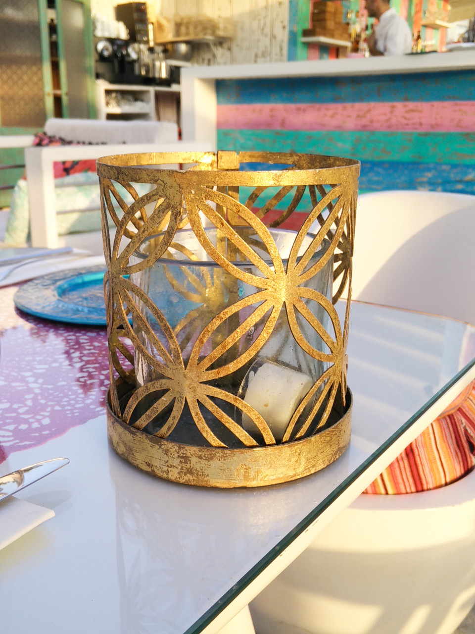 Tarnished gold candle holder with cutout design